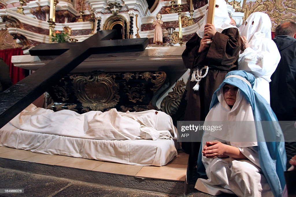 The 'catenacciu,' a hooded and chained penitent reenacts the crucifixion of Jesus Christ as part of a Good Friday in the village of Bisinchi, on the French mediterranean Island of Corsica, on March 30, 2013.
