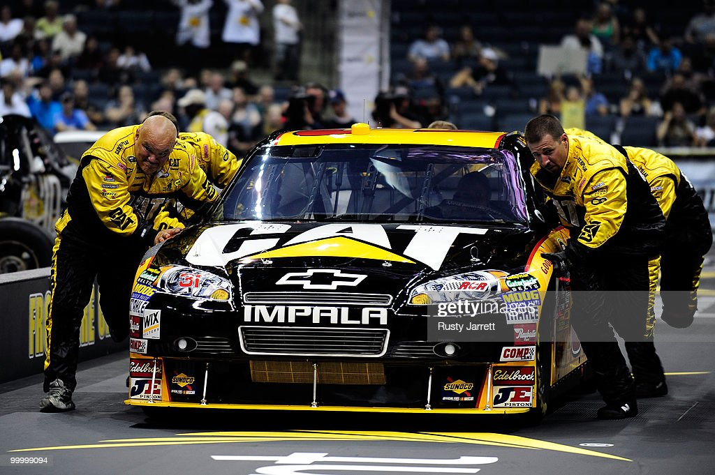 The #31 Caterpillar Chevrolet pit crew race during the NASCAR Sprint Pit Crew Challenge at Time Warner Cable Arena on May 19, 2010 in Charlotte, North Carolina.