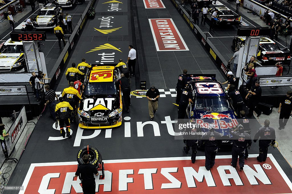 The #31 Caterpillar Chevrolet pit crew race the #83 Red Bull Toyota pit crew during the NASCAR Sprint Pit Crew Challenge at Time Warner Cable Arena on May 19, 2010 in Charlotte, North Carolina.
