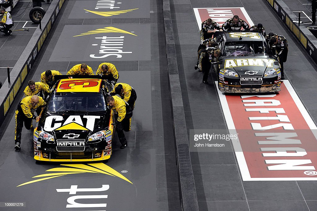 The #31 Caterpillar Chevrolet pit crew race the #39 U.S. Army Chevrolet pit crew during the NASCAR Sprint Pit Crew Challenge at Time Warner Cable Arena on May 19, 2010 in Charlotte, North Carolina.