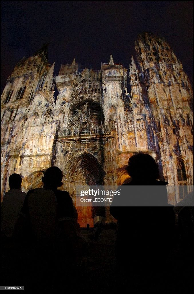 The Cathedrale de Rouen was lit in colors of Monet's works In Rouen, France On June 24, 2006-Rouen was changed to the new, the front yard of Rouen Cathedral in giant theater of light. From 23 June to 17 September, the spectacle of Skertzo lighting designers take the life back. Every summer evening, the front of the formidable Gothic monument becomes the occasion for a huge oil painting canvas on which were applied in movement the colors inspired by <a gi-track='captionPersonalityLinkClicked' href=/galleries/search?phrase=Claude+Monet&family=editorial&specificpeople=79875 ng-click='$event.stopPropagation()'>Claude Monet</a>'s famous series of paintings of the cathedral. At the initiative of this project, the city of Rouen and its service and Heritage Tourism.