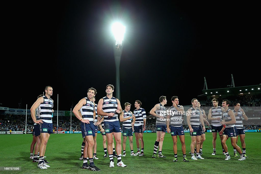 The Cats celebrate winning the round ten AFL match between the Geelong Cats and the Gold Coast Suns at Simonds Stadium on June 1, 2013 in Geelong, Australia.