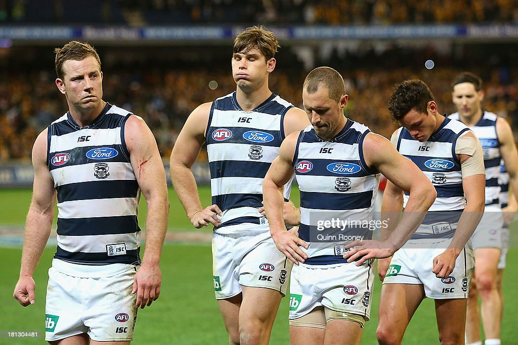The Cats look dejected after losing the AFL First Preliminary FInal match between the Hawthorn Hawks and the Geelong Cats at the Melbourne Cricket Ground on September 20, 2013 in Melbourne, Australia.