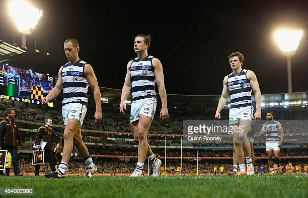 The Cats look dejected as they leave the field after losing the round 22 AFL match between the Hawthorn Hawks and the Geelong Cats at Melbourne...