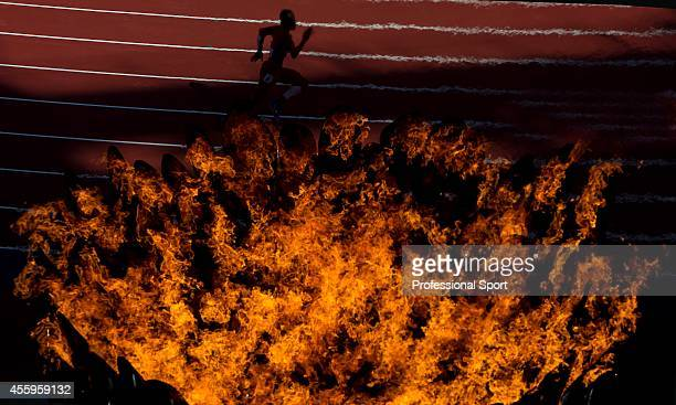 The cauldron bearing the Olympic flame burning inside the Olympic stadium during the athletics action of the London 2012 Paralympic Games at the...