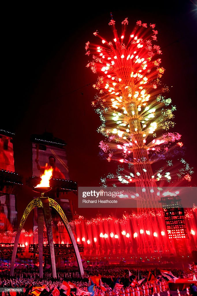 The cauldron is lit as fireworks light up the Guangzhou television tower during the Opening Ceremony for the 16th Asian Games Guangzhou 2010 at Haixinsha Square on November 12, 2010 in Guangzhou, China.