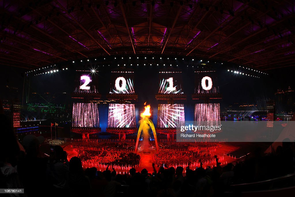 The cauldron is lit during the Opening Ceremony for the 16th Asian Games Guangzhou 2010 at Haixinsha Square on November 12, 2010 in Guangzhou, China.
