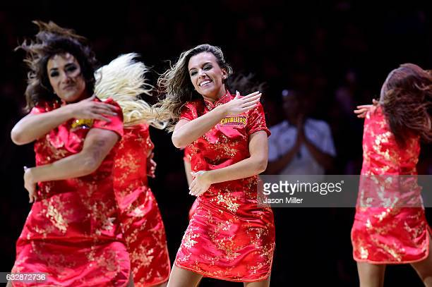 The Cavalier Girls perform a dance routine in celebration of the Chines New Year during the first half against the Brooklyn Nets at Quicken Loans...