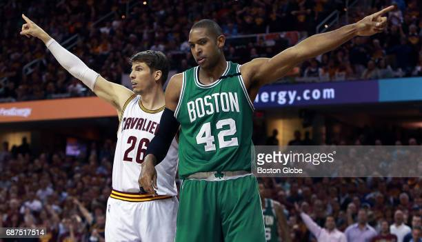 The Cavaliers' Kyle Korver left and the Celtics' Al Horford right have a different opinion on which team should be given possession on a second half...
