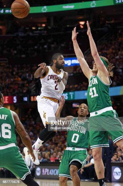 The Cavaliers' Kyrie Irving fires a no look pass while in the air in front of the Celtics' Avery Bradley and Kelly Olynyk The Boston Celtics visit...