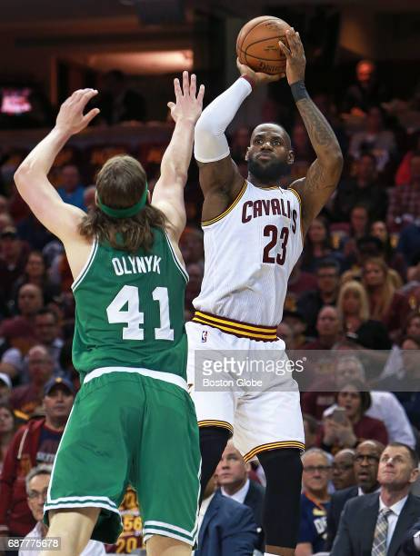 The Cavaliers' LeBron James fires up a shot against the defense of the Celtics' Kelly Olynyk The Boston Celtics visit the Cleveland Cavaliers for...