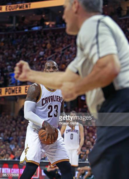 The Cavaliers' LeBron James looks on as a referee is signaling an offensive foul called against him on a second quarter charge into the Celtics'...