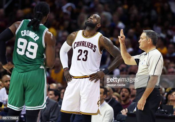 The Cavaliers' LeBron James watches the replay of his third foul of the game in the second quarter The Boston Celtics visit the Cleveland Cavaliers...