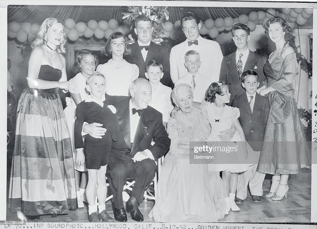The Cecil B Demilles celebrate their Golden Wedding Anniversary surrounded by an even dozen of their grandchildren The group shows front row William...