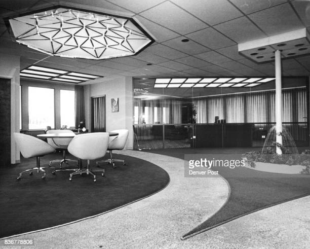 The ceiling in this huge room office of Lloyd Reed Shows varied types of lighting devices which his firm handles in addition to spaceage hospital...