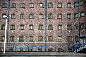 The cell windows of one of the wings at Liverpool prison watched over by a security camera in the prisons courtyard HMP Liverpool in Merseyside was...