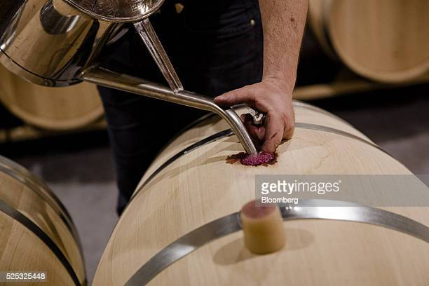 The cellar master tops up a wine barrel at Chateau Marquis d'Alesme in Margaux France on Thursday April 14 2016 Bordeaux has been a male bastion for...