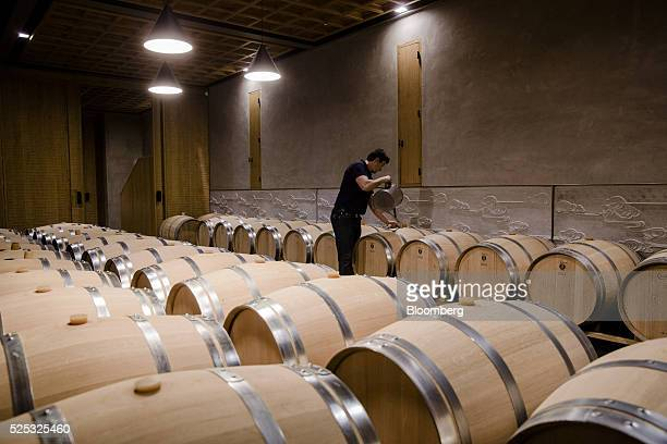 The cellar master tops up wine barrels at Chateau Marquis d'Alesme in Margaux France on Thursday April 14 2016 Bordeaux has been a male bastion for...