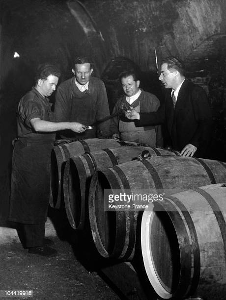 The Cellermen Of The Restaurant Maxim'S In Paris Tasting The Barreled Wine In The 1950'S
