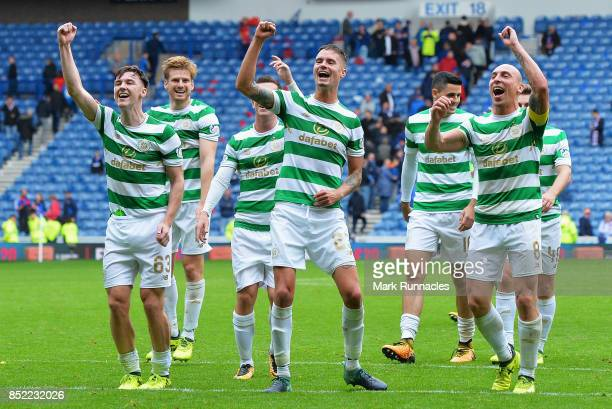 The Celtic team celebrate victory after the Ladbrokes Scottish Premiership match between Rangers and Celtic at Ibrox Stadium on September 23 2017 in...