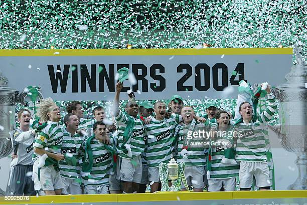 The Celtic team celebrate with the trophy after winning the 119th Scottish Tennents Cup Final between Celtic and Dunfermline held at Hampden Park on...