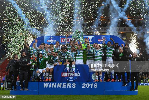 The Celtic team pose after winning the Betfred Cup Final between Aberdeen FC and Celtic FC at Hampden Park on November 27 2016 in Glasgow Scotland