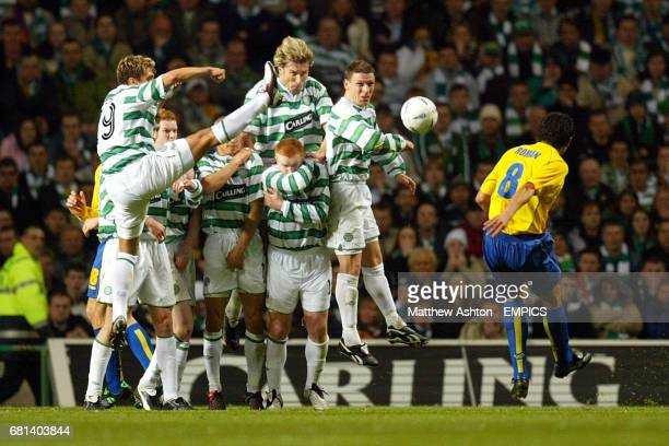 The Celtic wall try to block a free kick from Villarreal's Juan Riquelme