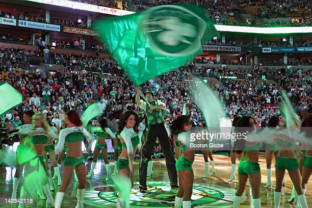 The Celtics Dancers and team mascot 'Lucky' are pictured during the pregame introductions as they do their thing under the green lights The Boston...