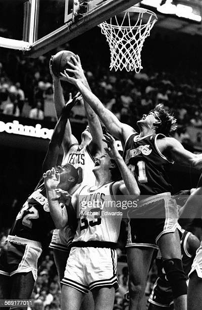 The Celtics Greg Kite comes up with a rebound in a battle with from left Magic Johnson Larry Bird and Kurt Rambis during Game 5 of the 1987 NBA...