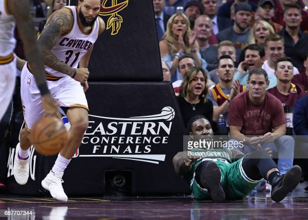 The Celtics' Jae Crowder is down on the floor as he watches the Cavaliers head up court with the ball after he fell on a drive to the basket The...