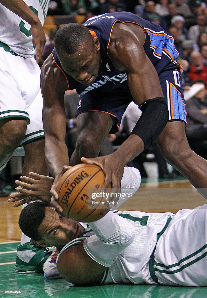 The Celtics' Jared Sullinger hit the floor as he draws a charge against the Bobcats Kemba Walker (#15) in the third quarter. He then braces himself for a possible landing spot for Charlotte's Bismack Biyombo (#0), who follows the ball as it bounces away. The Boston Celtics hosted the Charlotte Bobcats in a regular season NBA game at TD Garden.