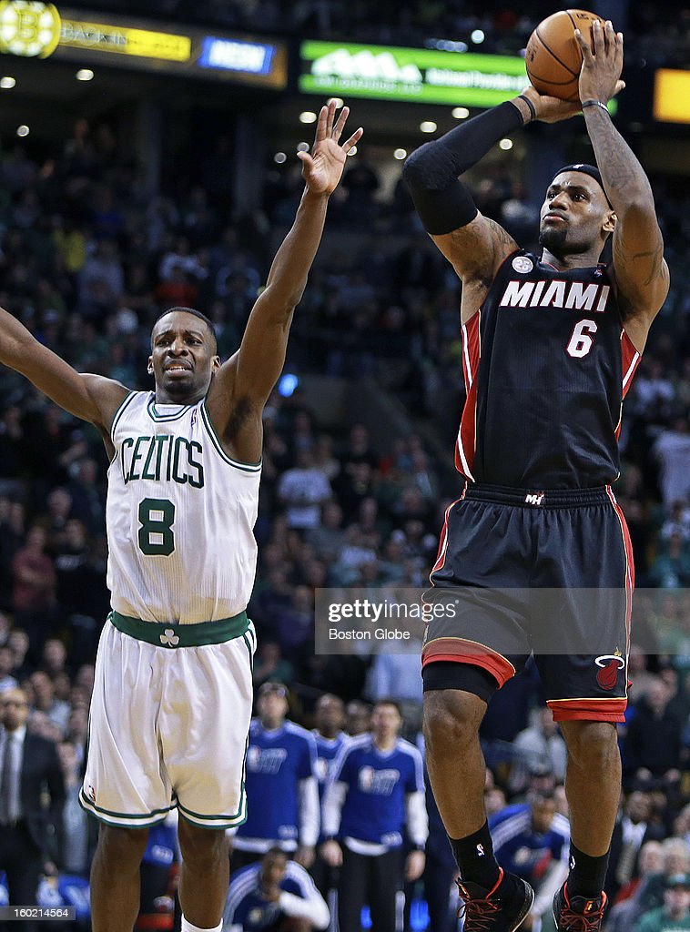 The Celtics' Jeff Green, left, can't stop Miami's LeBron James, right, as he hits this three pointer with a few seconds left in regulation to send the game into the first of two overtime periods as the Boston Celtics hosted the Miami Heat in an NBA regular season game at the TD Garden.