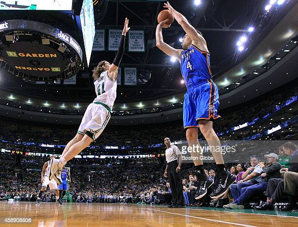 The Celtics Kelly Olynyk leaps to try and stop a fourth quarter shot by the Thunder's Nick Collison The Boston Celtics hosted the Oklahoma City...