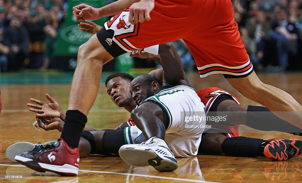 The Celtics' Kevin Garnett and the Bulls' Jimmy Butler hit the floor during a fourth quarter loose ball scramble, and when Garnett got the ball to teammate Brandon Bass, not pictured, out of the scrum, Bass was fouled by Chicago's Joakim Noah, not pictured, which brought a scream of delight from Garnett that turned into a satisfied smile. The Boston Celtics hosted the Chicago Bulls in an NBA regular season basketball game at the TD Garden.