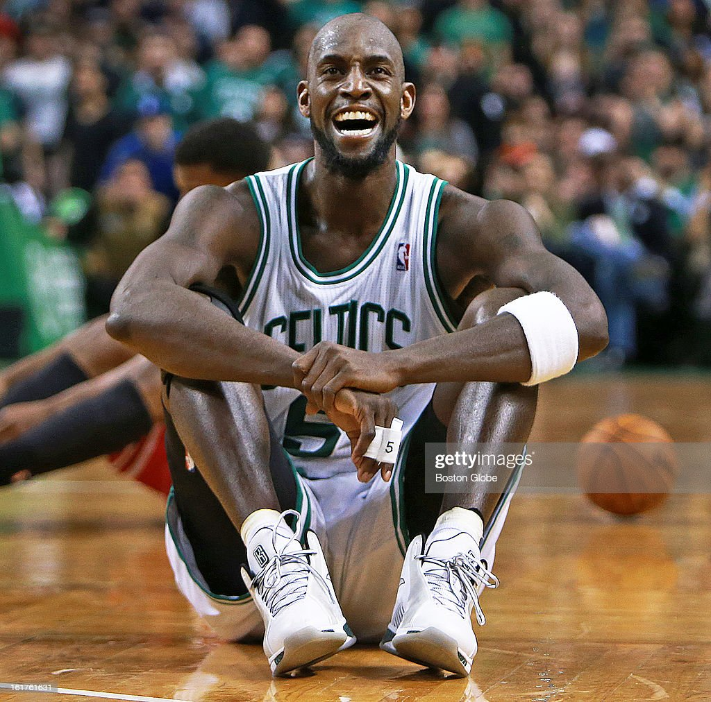 The Celtics' Kevin Garnett and the Bulls' Jimmy Butler hit the floor during a fourth quarter loose ball scramble, and when Garnett got the ball to teammate Brandon Bass, not pictured, out of the scrum, Bass was fouled by Chicago's Joakim Noah, not pictured, which brought a scream of delight from Garnett that turned into a satisfied smile, seen here. The Boston Celtics hosted the Chicago Bulls in an NBA regular season basketball game at the TD Garden.