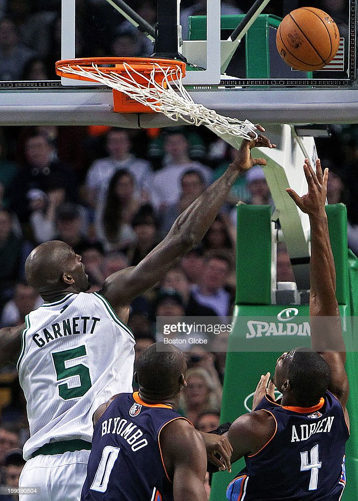 The Celtics' Kevin Garnett didn't get the ball, but he did get his fingers tied up in the net as he tried to block a shot by Charlottes' Jeff Adrien in the second quarter as the Boston Celtics hosted the Charlotte Bobcats in a regular season NBA game at TD Garden.