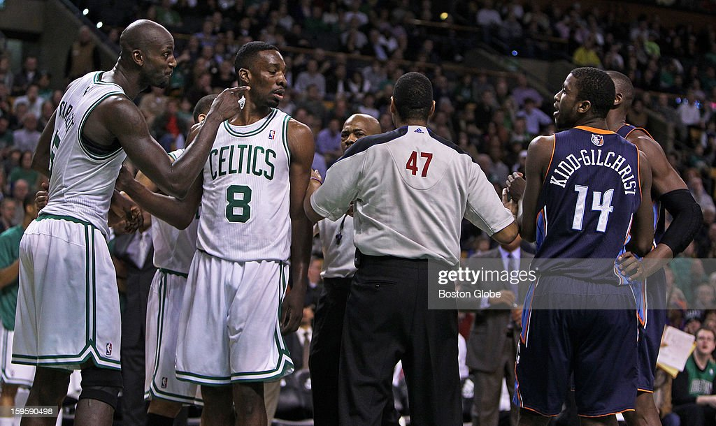 The Celtics' Kevin Garnett, far left, points in the direction of Charlotte's Gerald Henderson, not pictured, as words were exchanged after a hard foul on Garnett in the second quarter as the Boston Celtics hosted the Charlotte Bobcats in a regular season NBA game at TD Garden.