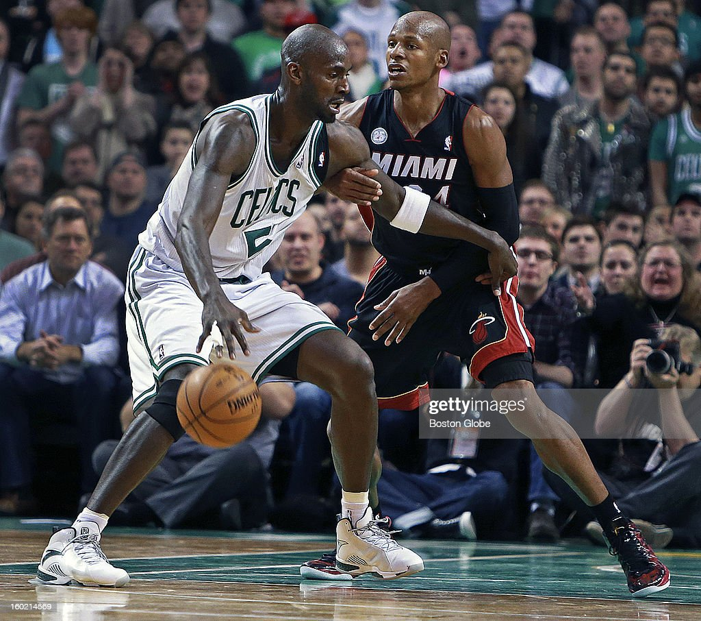 The Celtics' Kevin Garnett, left, was guarded by former teammate and current Heat guard Ray Allen in the fourth quarter as the Boston Celtics hosted the Miami Heat in an NBA regular season game at the TD Garden.