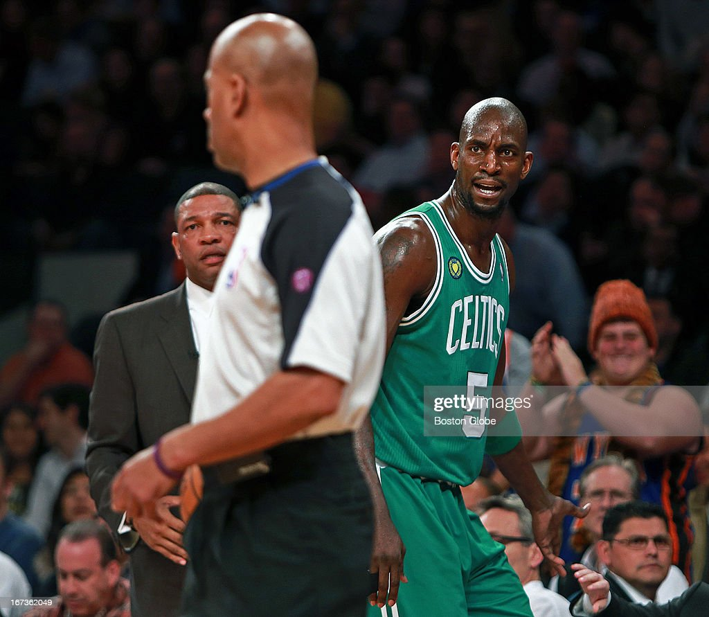 The Celtics Kevin Garnett scowls at an official as he heads to the bench early in the game after picking up his second personal foul. Head coach Doc Rivers stares at left, and a Knicks fans cheers at right. The Boston Celtics visited the New York Knicks for Game Two of an NBA Eastern Conference Quarter Final series at Madison Square Garden.