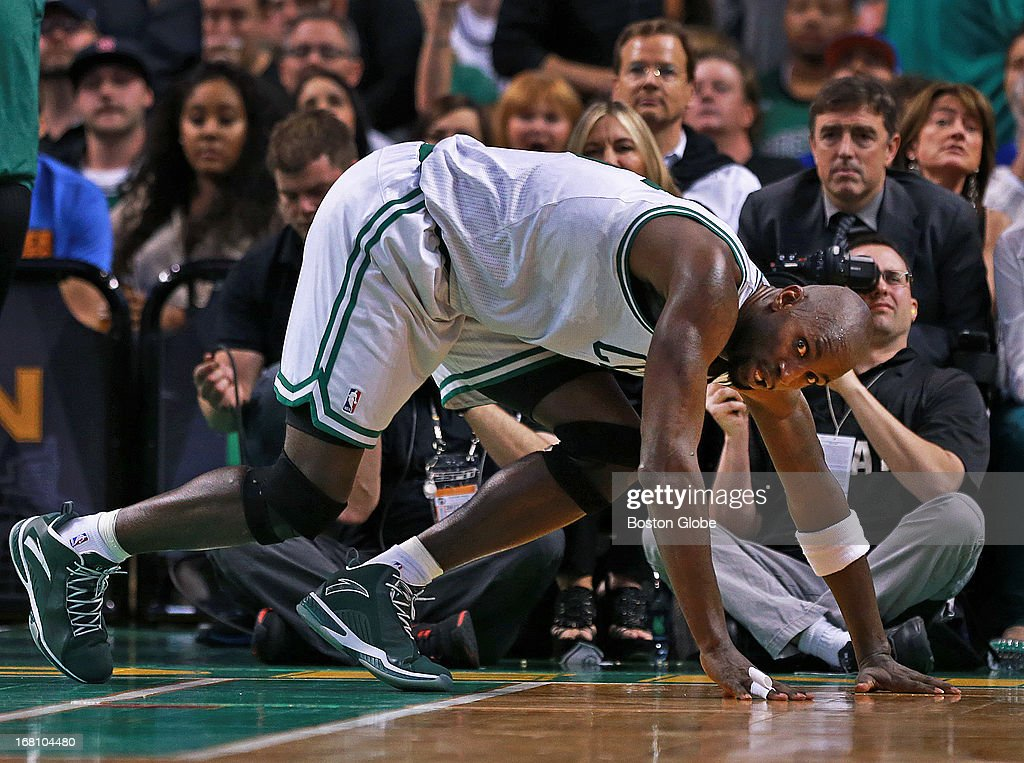The Celtics Kevin Garnett, with team owner Wyc Grousbeck behind him, gets knocked to the floor under the hoop and watches the action head the other way in the first half. The Boston Celtics hosted the New York Knicks for Game Six of the NBA Eastern Conference Quarterfinals at the TD Garden.