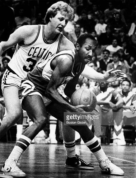 The Celtics' Larry Bird moves in on the Hawks' Johnny Davis as the Boston Celtics play the Atlanta Hawks at Boston Garden on Dec 21 1983