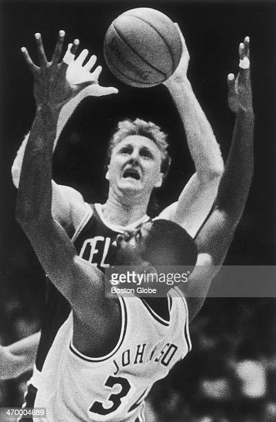 The Celtics' Larry Bird puts up a shot over the Lakers' Magic Johnson as the Boston Celtics play the Los Angeles Lakers at Boston Garden on June 4...