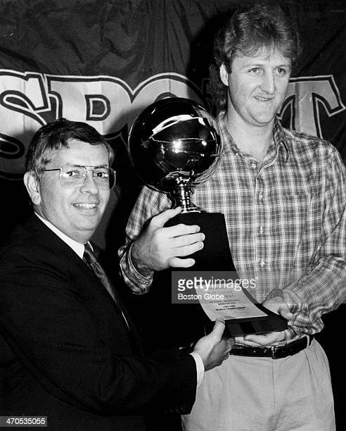 The Celtics' Larry Bird with the MVP trophy awarded him for his performance in the NBA finals With Bird is NBA Commissioner David Stern