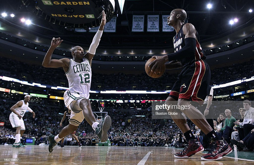 The Celtics' Leandro Barbosa, left, is too late on defense to stop Miami's Ray Allen from taking a second half three point shot fro the corner as the Boston Celtics hosted the Miami Heat in an NBA regular season game at the TD Garden.