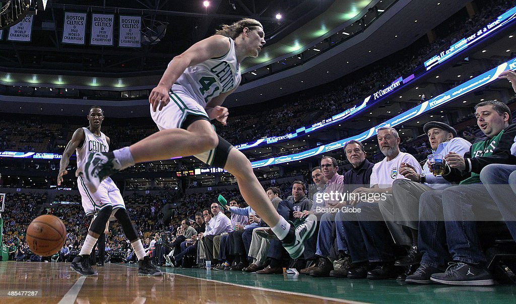 The Celtics may have been losing, and their season was winding down, but that didn't stop rookie Kelly Olynyk from hustling after a second half loose ball, and winding up in the front row on top of a fan. The Boston Celtics hosted the Washington Wizards in their final NBA game of the season at the TD Garden on Wednesday, April 16, 2014.