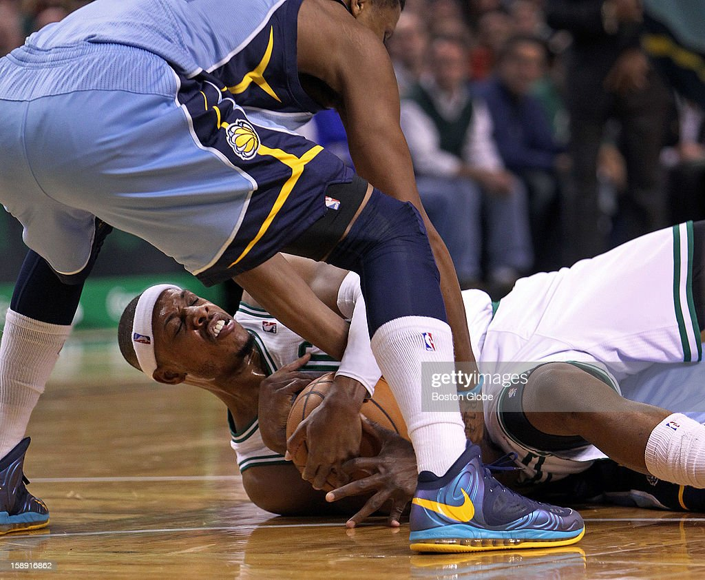 The Celtics' Paul Pierce battles with Memphis' Tony Allen (behind him on floor) for a second quarter loose ball that resulted in a jump ball as the Boston Celtics hosted the Memphis Grizzlies in a regular season NBA game at TD Garden. Rudy Gay is standing over them.