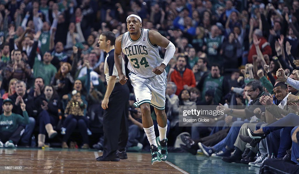 The Celtics' Paul Pierce brings the crowd out of their seats after he hit a huge shot over Miami's LeBron James, not pictured, in the second overtime to give Boston a 99-98 lead as the Boston Celtics hosted the Miami Heat in an NBA regular season game at the TD Garden.