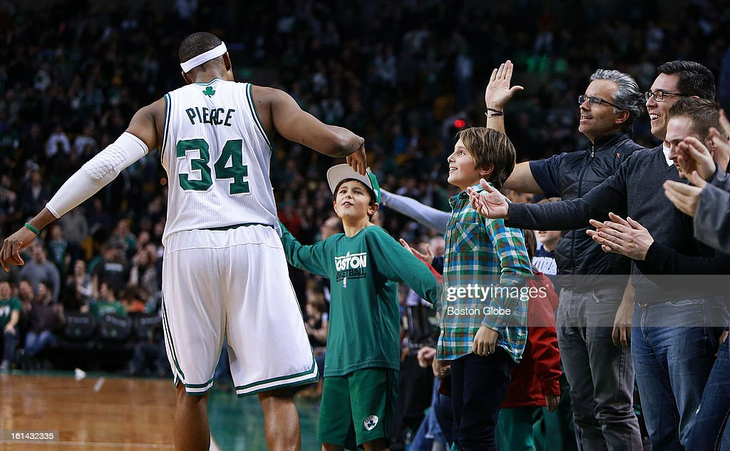 The Celtics' Paul Pierce (#34) celebrates with front row fans after Boston stopped Denver's last shot attempt in the second overtime period, sending the contest to the third (and final) ovetime period. The Boston Celtics hosted the Denver Nuggets in a regular season NBA game at the TD Garden.