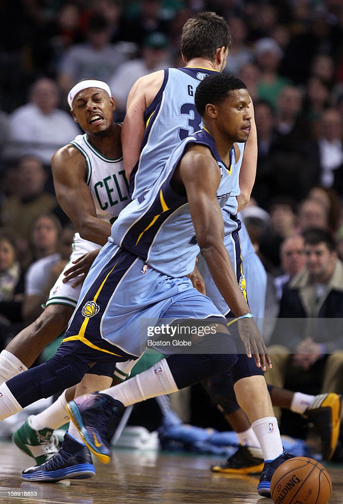 The Celtics' Paul Pierce is stopped cold by a first half pick set by Memphis' Marc Gasol, which allows Rudy Gay to continue his drive as the Boston Celtics hosted the Memphis Grizzlies in a regular season NBA game at TD Garden.