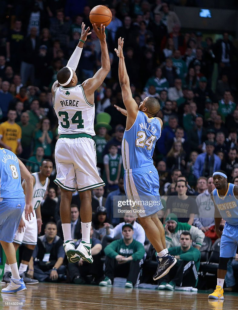 The Celtics' Paul Pierce launches a three pointer over Denver's Andre Miller (#24) with less than six seconds to go in the second overtime, he hit it to tie the game at 107. It was reviewed to see whether or not his foot hit the line, making it a two point shot, but the call on the floor was upheld, and the game would go to the third overtime period. The Boston Celtics hosted the Denver Nuggets in a regular season NBA game at the TD Garden.